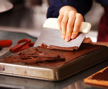 See chocolatiers at work making yummy chocolates